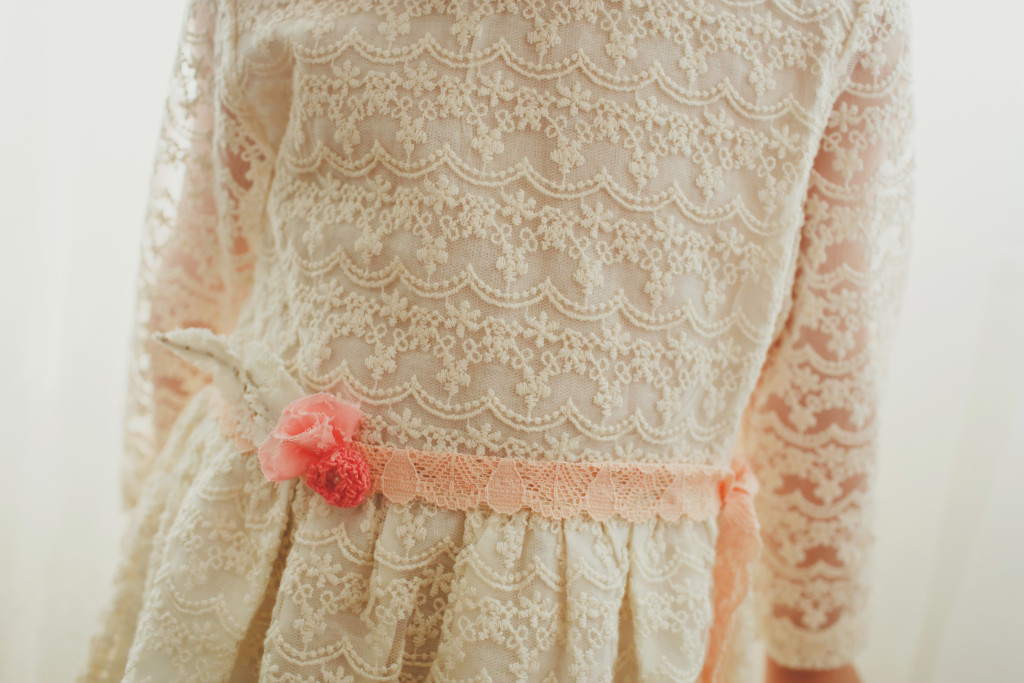 This custom sash made by La La Lace gave this dress the sweetest little pop of color,